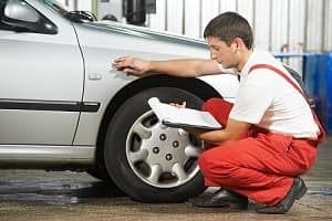 Mechanic Inspecting Used Car