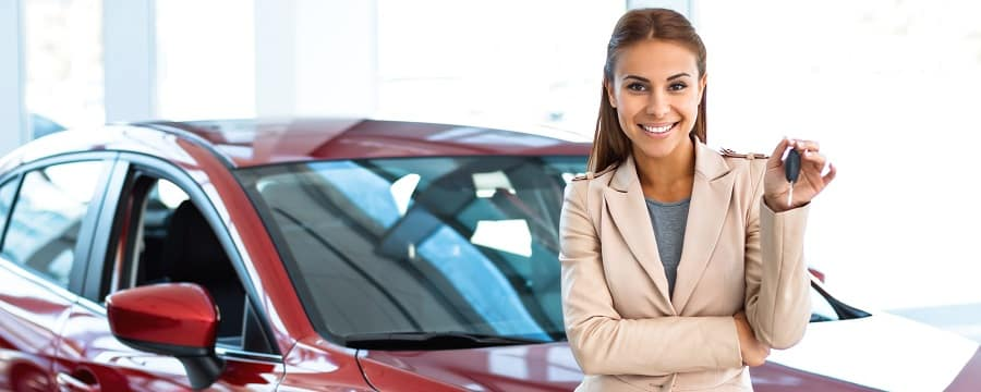 Saleswoman with Used Car