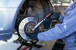 Man Fixing Brakes