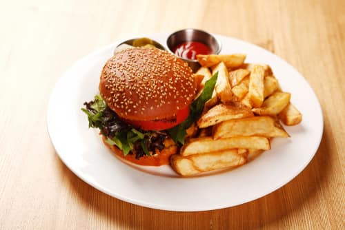 hamburger on a plate with fries