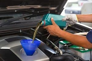Pouring Engine Oil