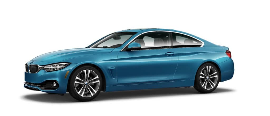 A new blue 2021 BMW 4 Series against a white background.
