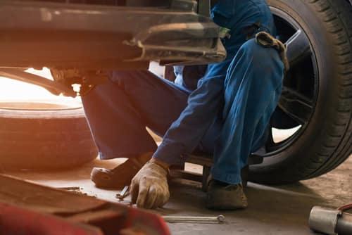 Mechanic working on brakes
