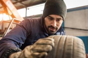 Service Tech Checking Tires