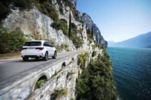 2020 Acura MDX A Spec in White Diamond Pearl Driving Around Mountain Cliff