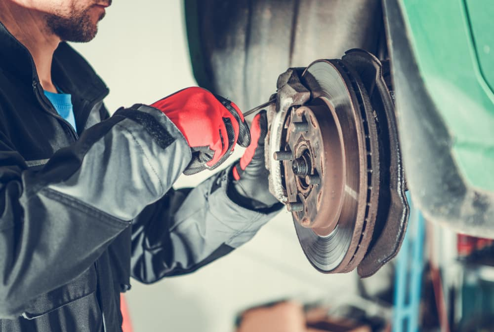 Mechanic Replacing Brakes in Maple Shade NJ