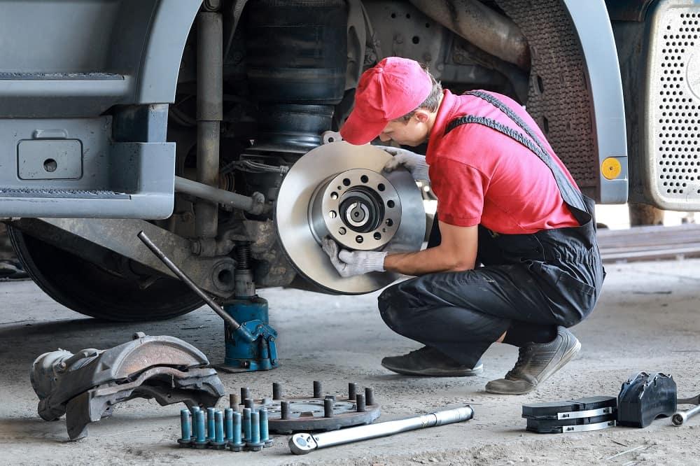 Man Fixing Brakes on Car