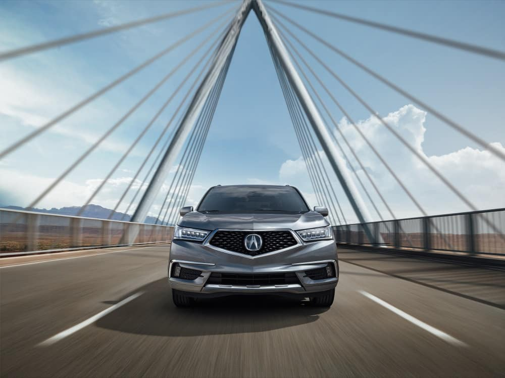 2020 Acura MDX Advance in Modern Steel Metallic Driving over Bridge