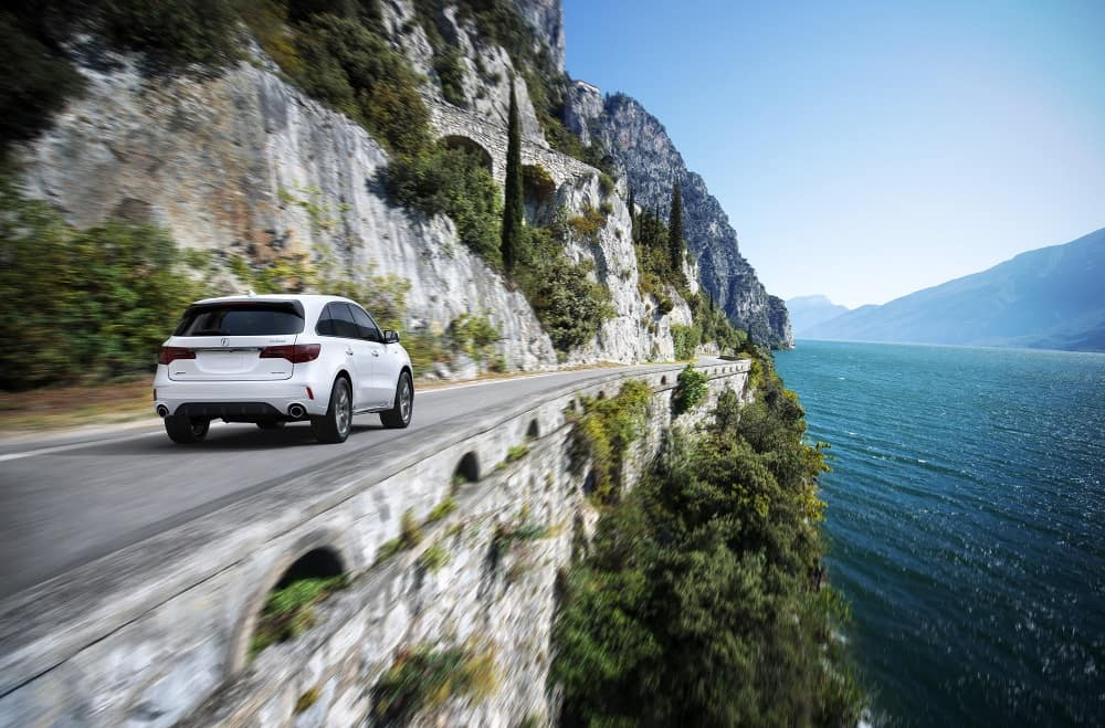 2020 Acura MDX SH-AWD A-Spec in White Diamond Pearl Driving around Mountain Cliff