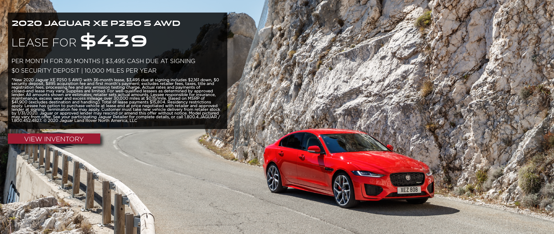 2020 JAGUAR XE P250 S AWD_$439 PER MONTH_36 MONTH LEASE TERM_$0 SECURITY DEPOSIT_$3,495 + TAX, LICENSE AND FEES DUE AT SIGNING_10,000 MILES PER YEAR_EXPIRES JANUARY 31, 2020_VIEW INVENTORY_RED JAGUAR XE DRIVING DOWN MOUNTAIN ROAD NEAR ROCK FORMATION