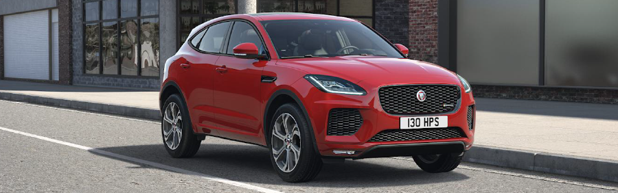RED JAGUAR E-PACE PARKED CURB SIDE IN CITY