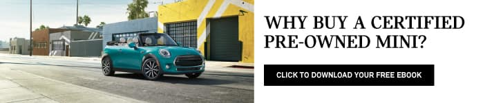 Why buy a certified pre-owned MINI? Click to download your free ebook. Picture shows a blue MINI cooper convertible driving down the street.