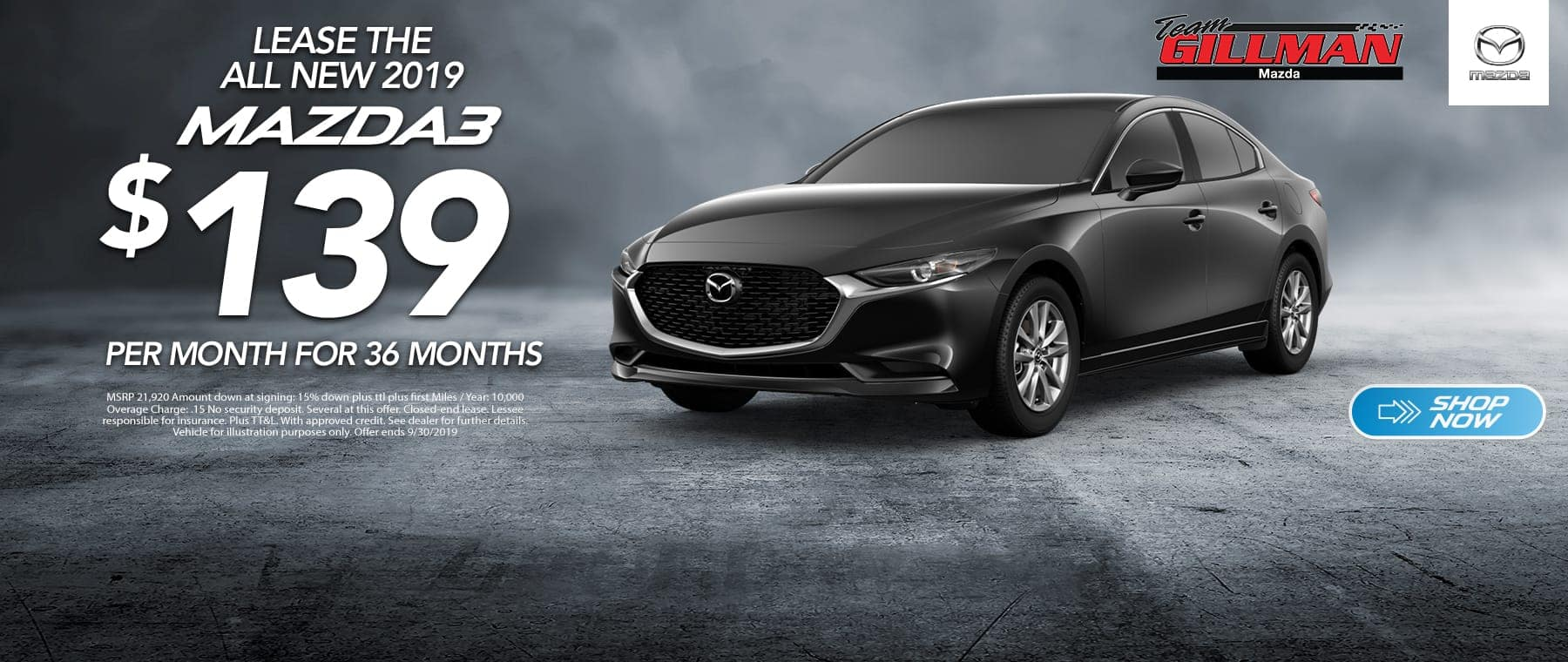 black Mazda3 on gray background