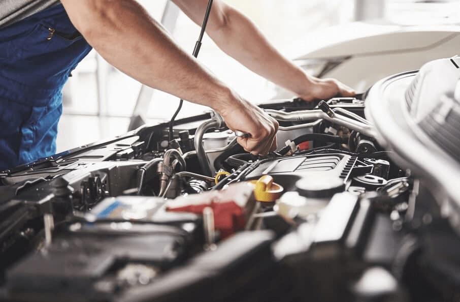 Mechanic Looking over Engine